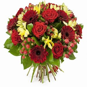 34783384 - bouquet of red roses  and gerberas isolated on white
